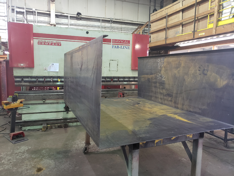 Bent Metal Plate for Fuel Containment Enclosure